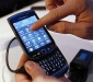 The new BlackBerry Torch 9800 smartphone is introduced at a news conference in New York August 3, 2010.   REUTERS/Shannon Stapleton (UNITED STATES - Tags: SCI TECH BUSINESS)